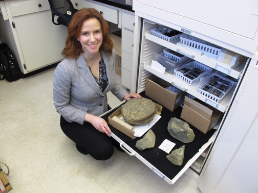 Image: Dr. Claeson at her home institution, Philadelphia College of Osteopathic Medicine, with a drawer containing some of the specimens collected on the 2016 expedition.